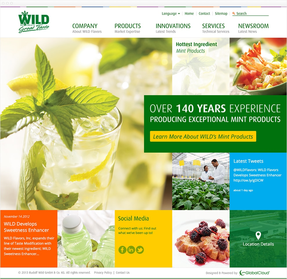 Screen capture of website with a header with a white background and green WILD flavors logo. The main nav is a horizontal list. The first item has a bold green headline that says Company with a sub-headline of About Wild Flavors. The second item has a bold green headline that says Products with a sub-headline of Market Expertise. The third item has a bold green headline that says Innovations with a sub-headline of Latest Trends. The fourth item has a bold green headline that says Services with a sub-headline of Technical Services. The fifth item has a bold green headline that says Newsroom with a sub-headline of Latest News. The main content of the homepage is a 5 column by 4 row grid of images and colors. The main image, a mojitos in a tall glass, takes up the first 3 rows and columns. A banner that breaks out the grid takes up 2 and half columns and 1 row. The break out banner has a green background with white text that says Over 140 Years Experience producing exceptional mint products. A yellow button with green text says Learn more about WILD's Mint Products. Other squares show links for locations, social media links, and latest tweets.